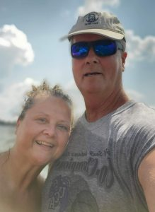 Sandra Tripp with her father at the lake